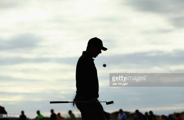 Rory McIlroy of Northern Ireland bounces his ball on his putter walks off the 10th green during the second round of the Dubai Duty Free Irish Open at...