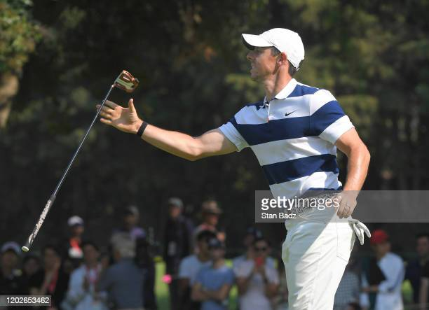 Rory McIlroy of Northern Ireland catches his putter on the 13th hole during the third round of the World Golf Championships-Mexico Championship at...