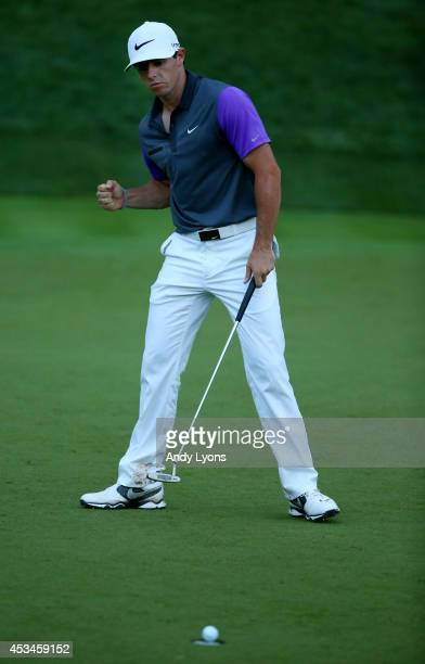 Rory McIlroy of Northern Ireland celebrates a putt for birdie on the 17th green during the final round of the 96th PGA Championship at Valhalla Golf...