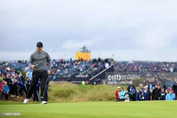 Rory McIlroy of Northern Ireland celebrates a putt on the 14th green during the second round of the 148th Open Championship held on the Dunluce Links...