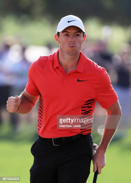 Rory McIlroy of Northern Ireland celebrates after chipping in for birdie on the 17th hole during round three of the Abu Dhabi HSBC Golf Championship...