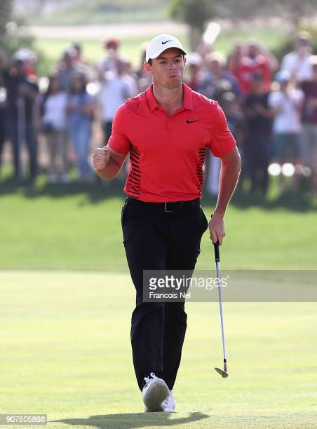 Rory McIlroy of Northern Ireland celebrates after chipping in for birdie on the 17th hole during the third round of the Abu Dhabi HSBC Golf...