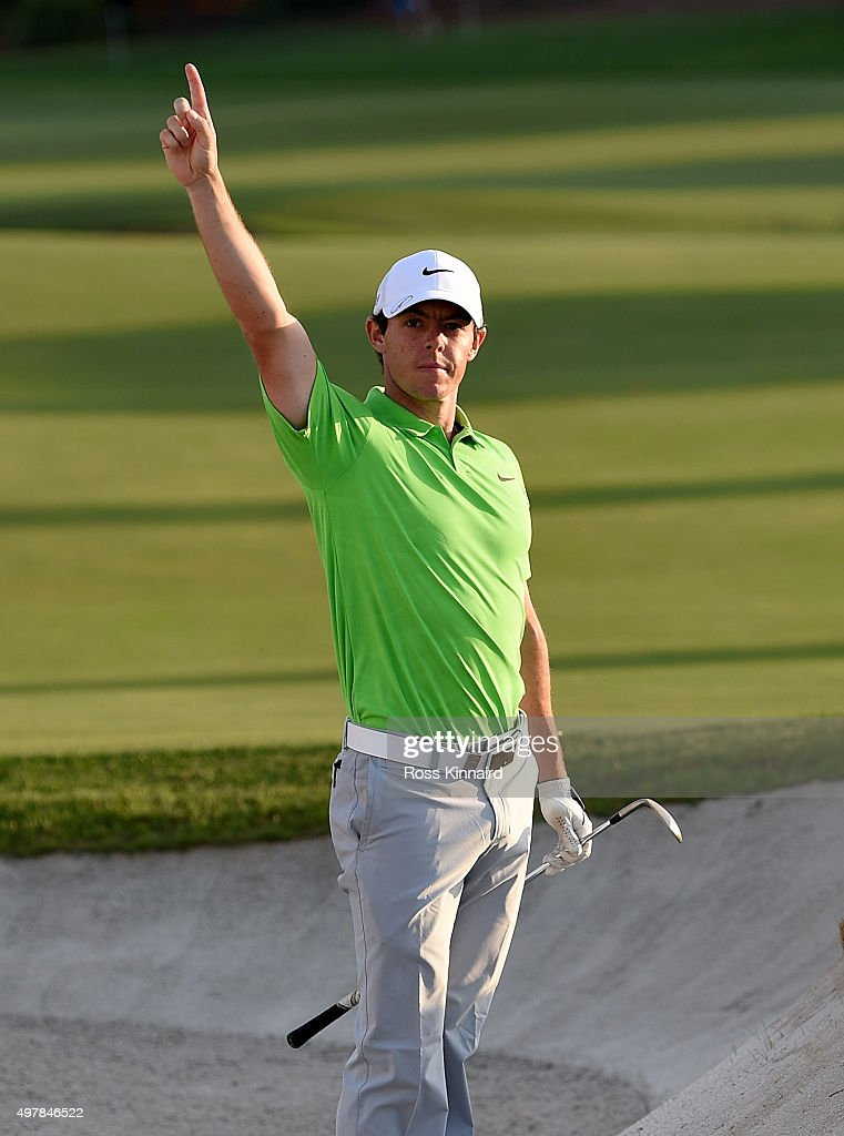 Rory McIlroy of Northern Ireland celebrates after he holes out from the bunker on 18 green during the first round of the DP World Tour Championship at Jumeirah Golf Estates on November 19, 2015 in Dubai, United Arab Emirates.
