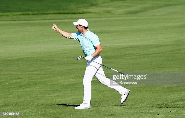 Rory McIlroy of Northern Ireland celebrates after holing a shot for eagle on the 16th hole during the final round of the TOUR Championship at East...