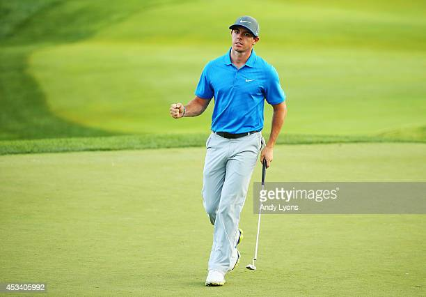 Rory McIlroy of Northern Ireland celebrates after making a putt for birdie on the 18th green to finish with a fourunder par 67 during the third round...