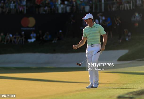 Rory McIlroy of Northern Ireland celebrates after making his birdie putt on the 18th green during the final round at the Arnold Palmer Invitational...