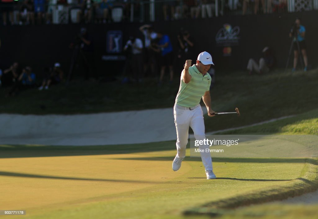 Rory McIlroy of Northern Ireland celebrates after making his birdie putt on the 18th green during the final round at the Arnold Palmer Invitational Presented By MasterCard at Bay Hill Club and Lodge on March 18, 2018 in Orlando, Florida.