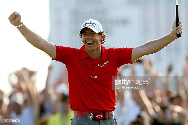 Rory McIlroy of Northern Ireland celebrates after putting on the 18th green during the Final Round of the 94th PGA Championship at the Ocean Course...