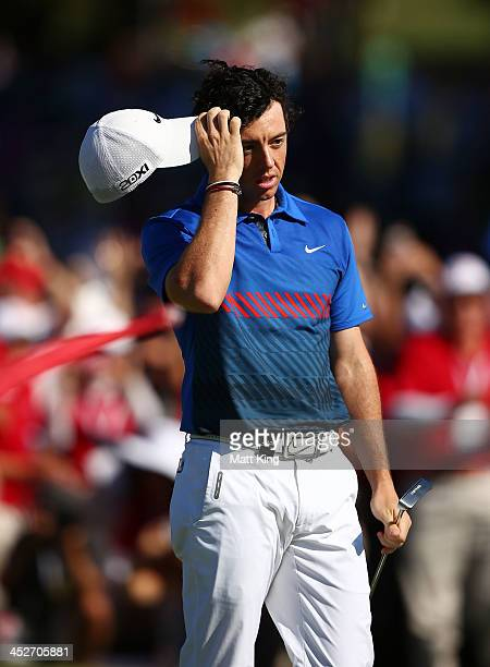 Rory McIlroy of Northern Ireland celebrates after sinking his birdie putt on the 18th hole to claim victory during day four of the 2013 Australian...