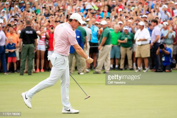 Rory McIlroy of Northern Ireland celebrates after winning on the 18th green during the final round of the TOUR Championship at East Lake Golf Club on...
