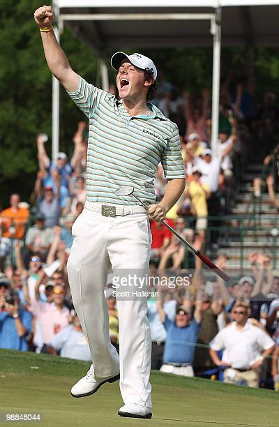 Rory McIlroy of Northern Ireland celebrates as he holes a birdie putt on the 18th green to secure victory during the final round of the 2010 Quail...