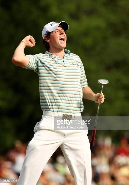 Rory McIlroy of Northern Ireland celebrates has he holes a birdie putt on the 18th green to secure victory during the final round of the Quail Hollow...