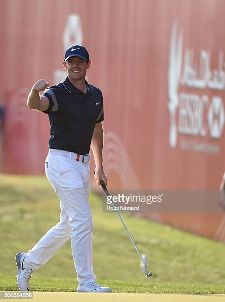 Rory McIlroy of Northern Ireland celebrates his eagle on the 18th green during the final round of the Abu Dhabi HSBC Golf Championship at the Abu...