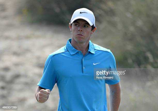 Rory McIlroy of Northern Ireland celebrates his eagle on the par five 3rd hole during the third round of the Omega Dubai Desert Classic on the Majlis...
