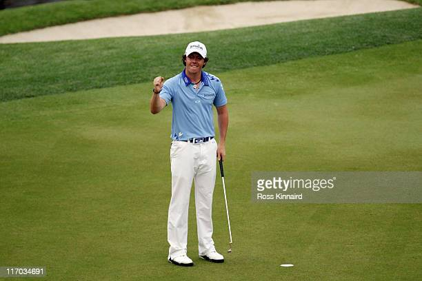 Rory McIlroy of Northern Ireland celebrates his eight-stroke victory on the 18th green to win during the 111th U.S. Open at Congressional Country...