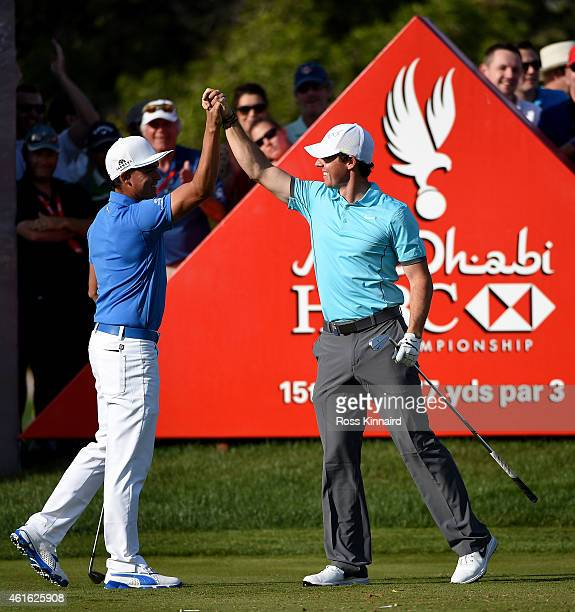 Rory McIlroy of Northern Ireland celebrates his 'holeinone' with Rickie Fowler of the USA on the par three 15th hole during the second round of the...