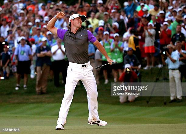 Rory McIlroy of Northern Ireland celebrates his one-stroke victory on the 18th green during the final round of the 96th PGA Championship at Valhalla...