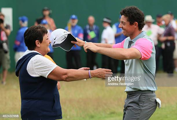 Rory McIlroy of Northern Ireland celebrates his two-stroke victory on the 18th green with his mother Rosie during the final round of The 143rd Open...