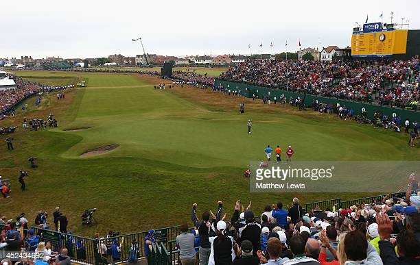Rory McIlroy of Northern Ireland celebrates his two-stroke victory on the 18th green during the final round of The 143rd Open Championship at Royal...