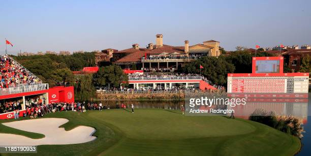 Rory McIlroy of Northern Ireland celebrates his victory in a playoff on the 18th green during Day Four of the WGC HSBC Champions at Sheshan...