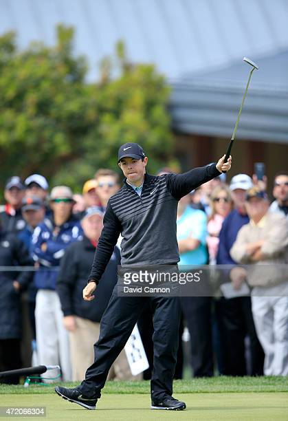 Rory McIlroy of Northern Ireland celebrates holing a long eagle putt on the par 5, 18th hole to defeat Jim Furyk by 1 hole during his semi final...