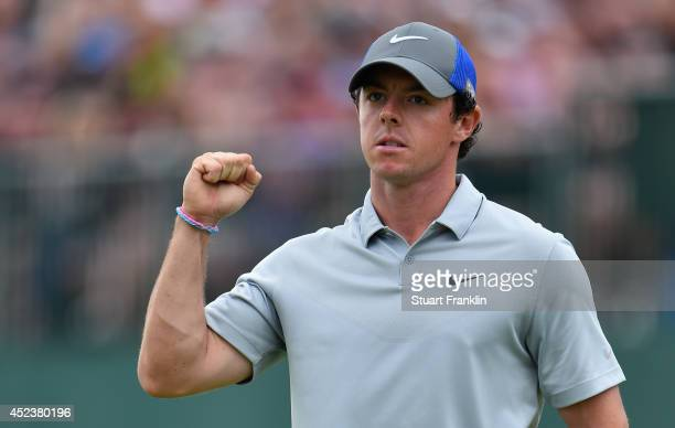 Rory McIlroy of Northern Ireland celebrates holing an eagle putt on the 18th green during the third round of The 143rd Open Championship at Royal...