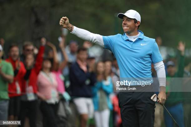 Rory McIlroy of Northern Ireland celebrates making eagle on the eighth hole during the third round of the 2018 Masters Tournament at Augusta National...