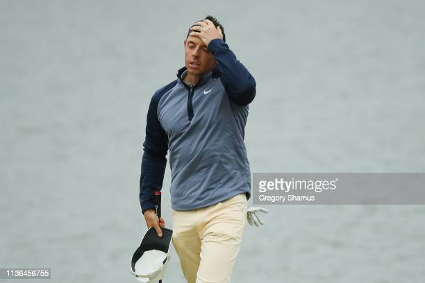 Rory McIlroy of Northern Ireland celebrates on the 18th green after finishing during the final round of The PLAYERS Championship on The Stadium...