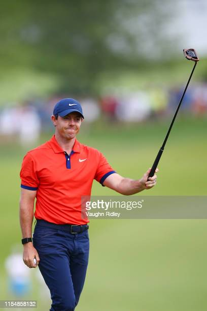 Rory McIlroy of Northern Ireland celebrates on the 18th green after making a putt to win the RBC Canadian Open at Hamilton Golf and Country Club on...
