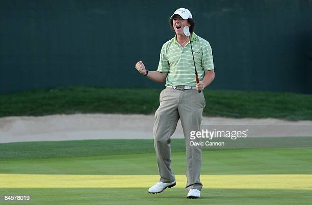 Rory McIlroy of Northern Ireland celebrates on the 18th green after winning the 2009 Dubai Desert Classic on the Majilis Course at the Emirates Golf...