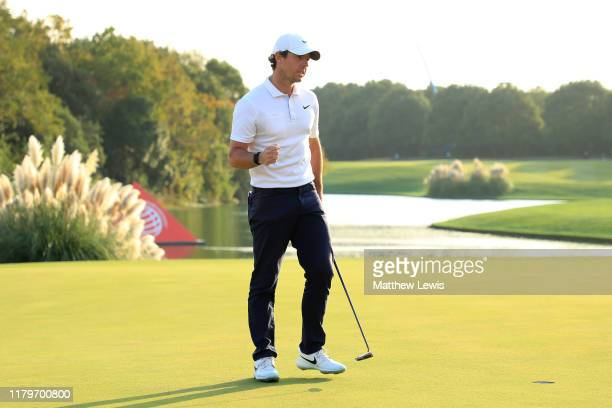 Rory McIlroy of Northern Ireland celebrates victory in a playoff on the 18th green during Day Four of the WGC HSBC Champions at Sheshan International...