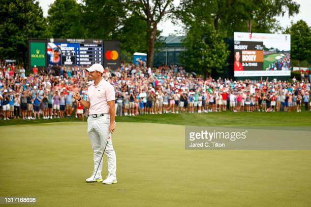 Rory McIlroy of Northern Ireland celebrates winning on the 18th green during the final round of the 2021 Wells Fargo Championship at Quail Hollow...