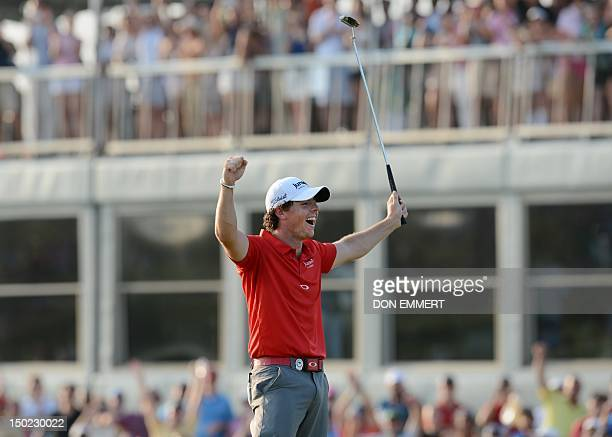 Rory McIlroy of Northern Ireland celebrates winning the 94th PGA Championship on the 18th green on August 12, 2012 on Kiawah Island, South Carolina....
