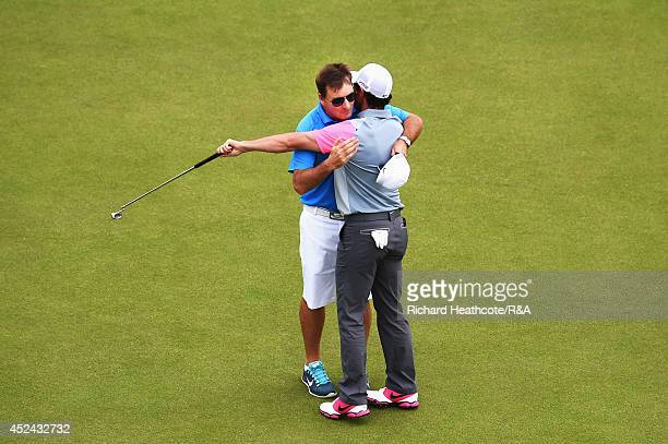 Rory McIlroy of Northern Ireland celebrates with his caddie JP Fitzgerald on the 18th green following his twostroke victory during the final round of...