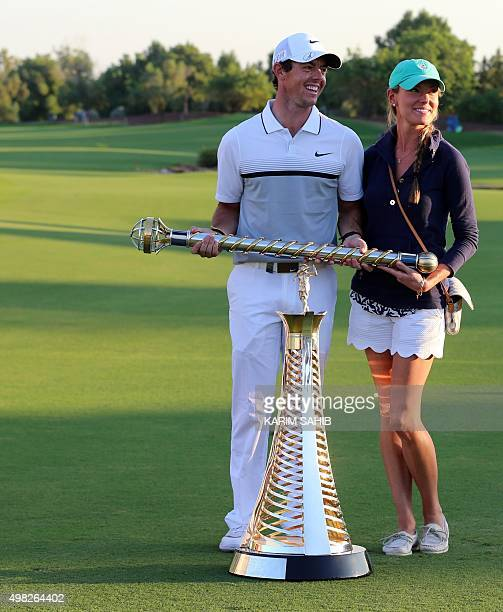 Rory McIlroy of Northern Ireland celebrates with his girlfriend Erica Stoll after winning the the DP World Tour Golf Championship in Dubai on...