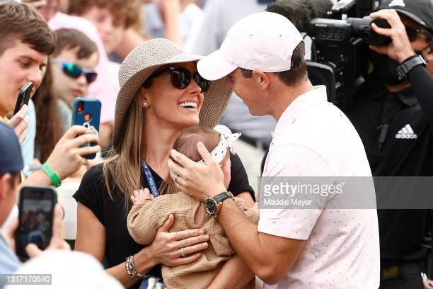 Rory McIlroy of Northern Ireland celebrates with his wife Erica and daughter Poppy after winning during the final round of the 2021 Wells Fargo...