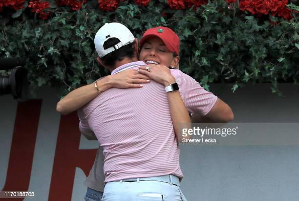 Rory McIlroy of Northern Ireland celebrates with his wife Erica Stoll after winning during the final round of the TOUR Championship at East Lake Golf...
