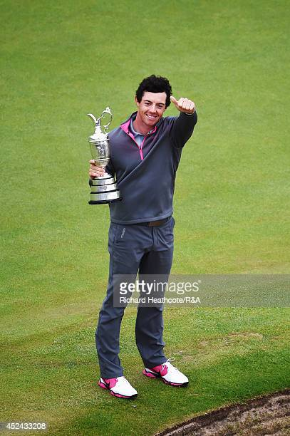 Rory McIlroy of Northern Ireland celebrates with the Claret Jug after his twostroke victory on the 18th green during the final round of The 143rd...