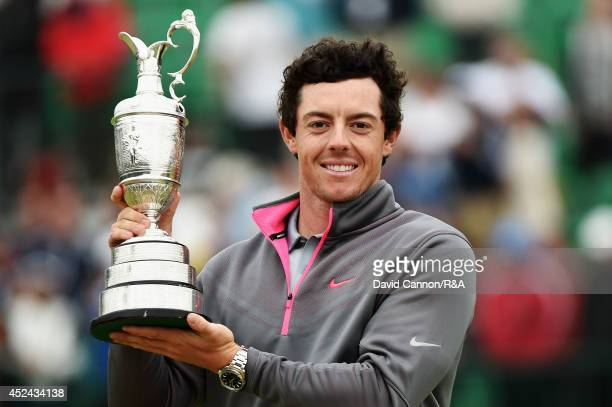 Rory McIlroy of Northern Ireland celebrates with the Claret Jug after his twostroke victory after the final round of The 143rd Open Championship at...