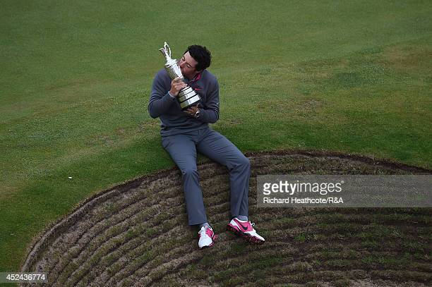 Rory McIlroy of Northern Ireland celebrates with the Claret Jug after his two-stroke victory after the final round of The 143rd Open Championship at...