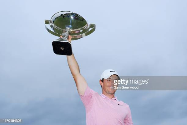 Rory McIlroy of Northern Ireland celebrates with the FedExCup trophy after winning during the final round of the TOUR Championship at East Lake Golf...