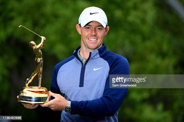 Rory McIlroy of Northern Ireland celebrates with the trophy after winning The PLAYERS Championship on The Stadium Course at TPC Sawgrass on March 17,...
