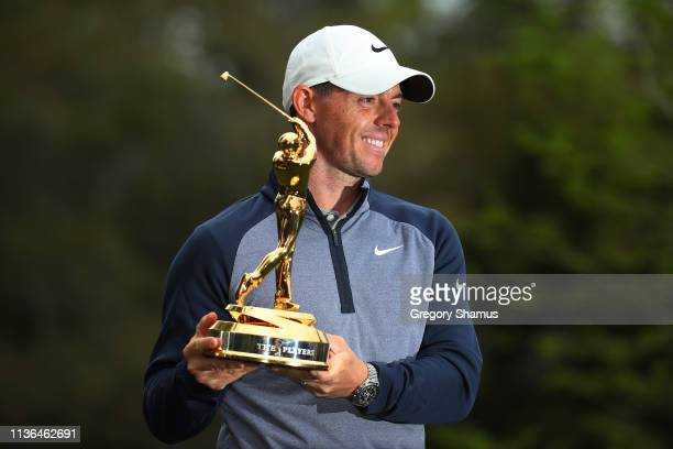 Rory McIlroy of Northern Ireland celebrates with the trophy after winning The PLAYERS Championship on The Stadium Course at TPC Sawgrass on March 17...