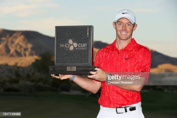 Rory McIlroy of Northern Ireland celebrates with the trophy after winning during the final round of THE CJ CUP @ SUMMIT at The Summit Club on October...