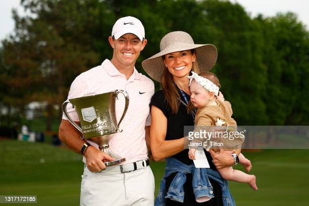Rory McIlroy of Northern Ireland celebrates with the trophy alongside his wife Erica and daughter Poppy after winning during the final round of the...
