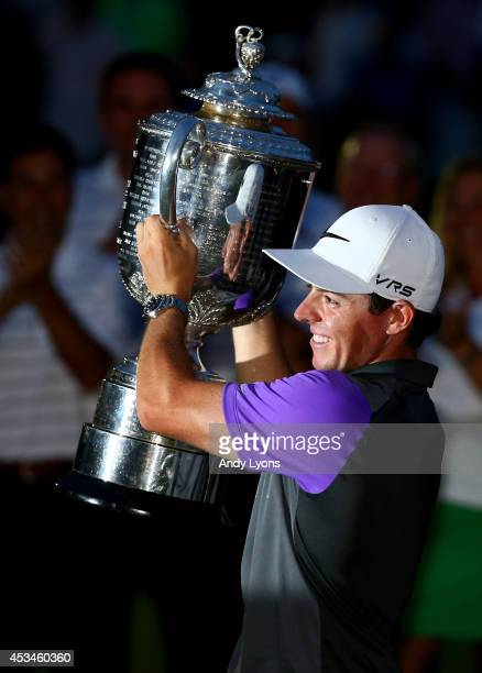 Rory McIlroy of Northern Ireland celebrates with the Wanamaker trophy after his onestroke victory during the final round of the 96th PGA Championship...