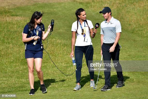 Rory McIlroy of Northern Ireland conducts an oncourse interview with Henni Zuel during a practice round prior to the 146th Open Championship at Royal...