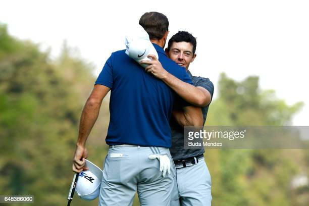 Rory McIlroy of Northern Ireland congratulates Dustin Johnson of the United States on winning the final round of the World Golf Championships Mexico...