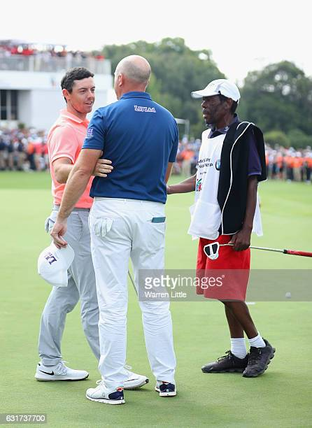Rory McIlroy of Northern Ireland congratulates Graeme Storm of England after victory in the third extra play off hole during the final round of the...