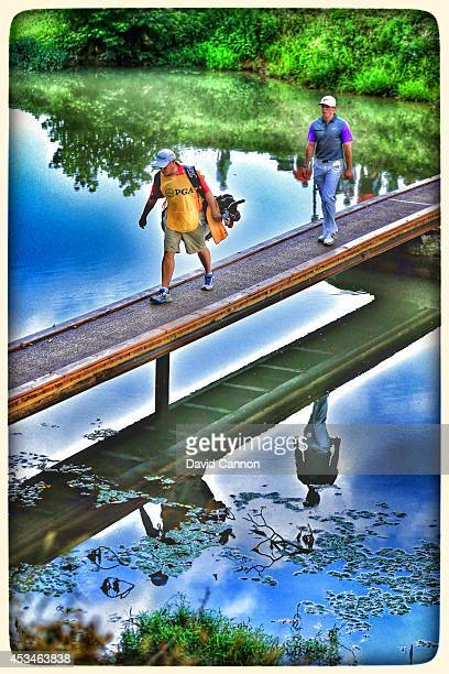 Rory McIlroy of Northern Ireland crosses the bridge on the nineth hole during the final round of the 96th PGA Championship at Valhalla Golf Club on...